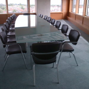 Glass Conference Table with Black Leather Chairs