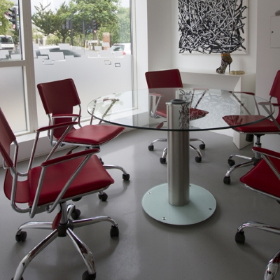 Clear Glass Round Meeting Table with Red Chairs