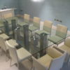 Large Glass Table and Chairs in Meeting Room