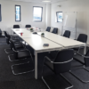 white rectangular meeting table with chairs