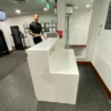 white reception counter for gym