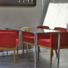 Small Glass Desk with Red Chairs