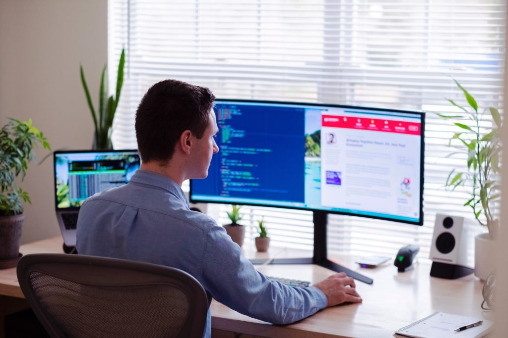 Man working from home with multiple monitors setup