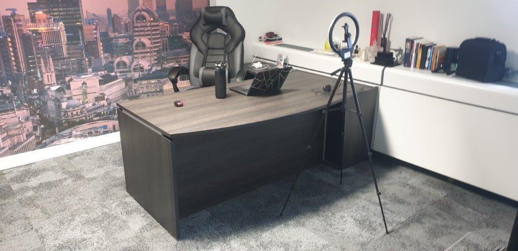 Large executive office desk in a dark brown oak finish