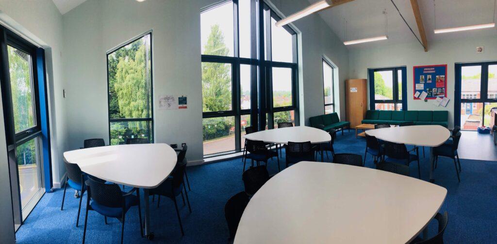 Classroom meeting tables arranged at St Faith & St Martin Church of England Junior School